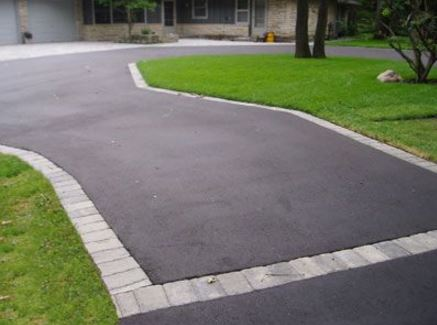 New asphalt driveway with paver edging