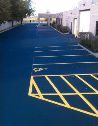 Asphalt parking lot repair, seal coat and ADA compliant striping